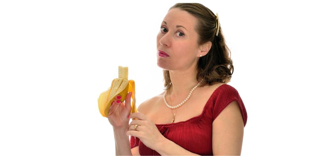 Woman Eating a Banana - feeling guilty